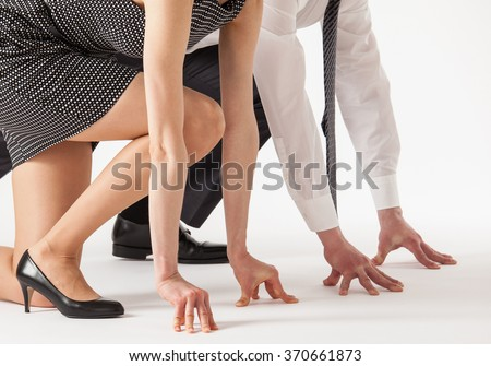 Business people competing, white background - stock photo
