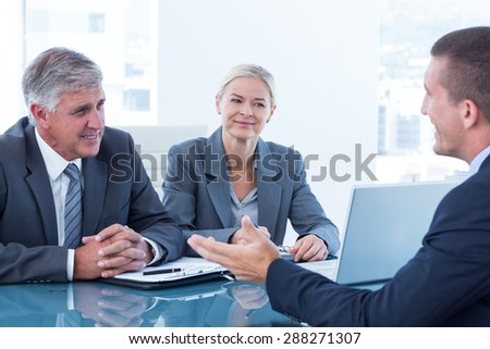 Business people conducting an interview in an office - stock photo