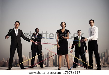 Business People Connected by Strings by New York City Skyline - stock photo