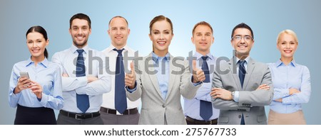 business, people, corporate, teamwork and office concept - group of happy businesspeople showing thumbs up over blue background - stock photo