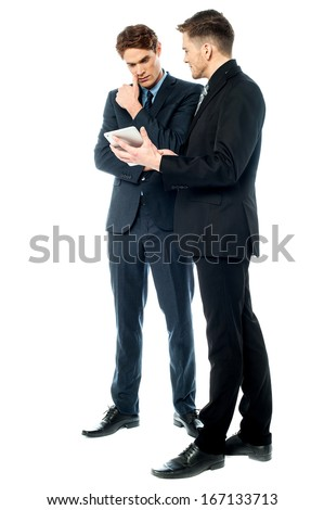 Business people discussing a presentation - stock photo