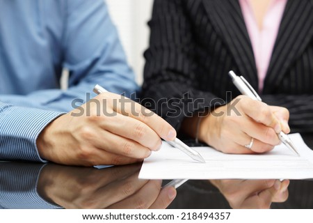 Business people discussing about a document - stock photo