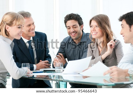 Business people discussing and working together during a meeting in office - stock photo
