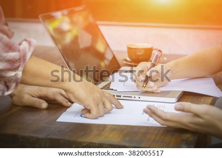 Business people discussing business strategy on the foreground, business partners hands during discussion of financial and business documents meeting Analyzing  Financial Data and Charts in the Office - stock photo