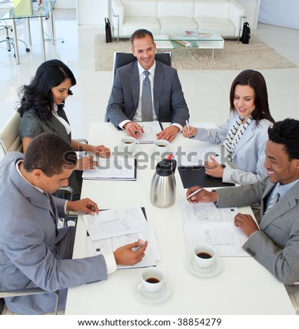 Business people discussing in a meeting a plan - stock photo