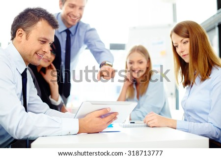 Business people discussing over digital tablet. Teamwork concept - stock photo