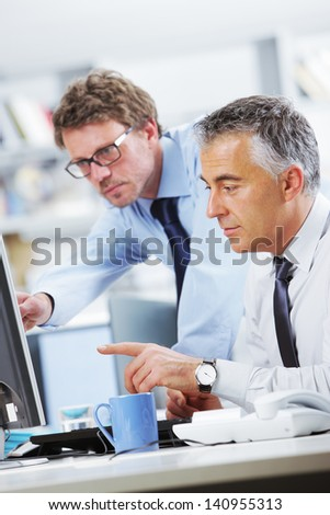 Business people, discussion at computer - stock photo