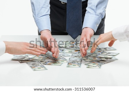 Business people distributing earnings, white background - stock photo