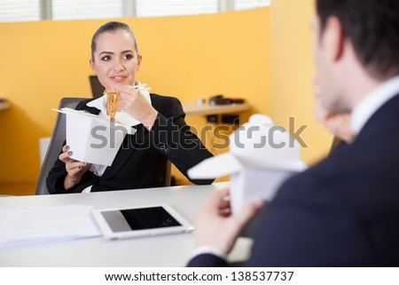 Business people eating chinese food in the office - stock photo
