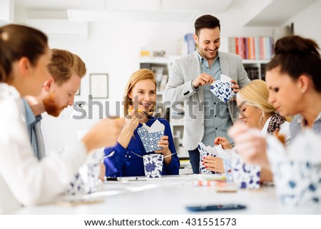 Business people eating meals in office - stock photo