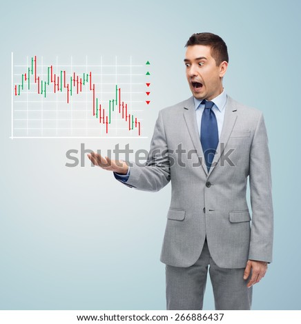 business, people, emotions and failure concept - shocked businessman in suit looking to chart over gray background - stock photo