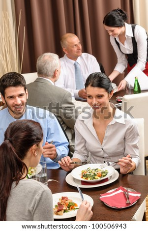 Business people enjoy lunch at the restaurant management discussion - stock photo