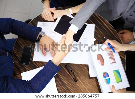Business People finishing up the meeting with a handshake - stock photo