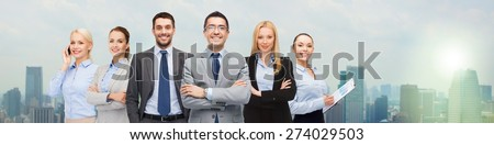 business, people, gesture and office concept - group of smiling businessmen over city background - stock photo