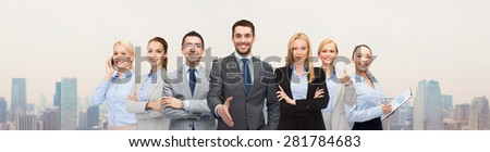 business, people, gesture and partnership concept - group of smiling businessmen making handshake over city background - stock photo
