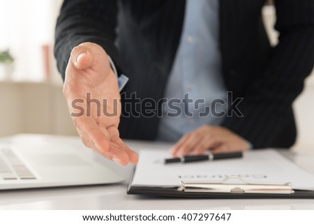 Business people giving him hand for handshake to partner. Concept of Agreement, Partnership, Teamwork, Welcome, Congrats. - stock photo
