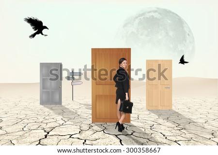 Business people going through door to desert  - stock photo