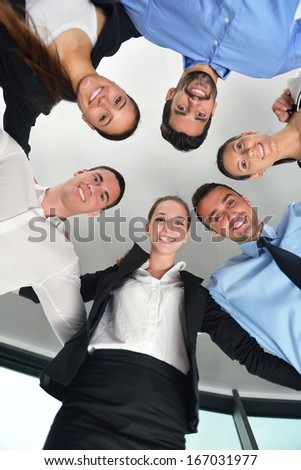 business people group joining hands and representing concept of friendship and teamwork,  low angle view - stock photo