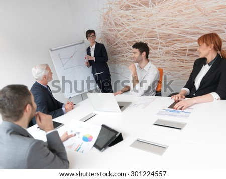 business people group on meeting at modern bright office indoors. Senior  businessman as leader in discussion. - stock photo
