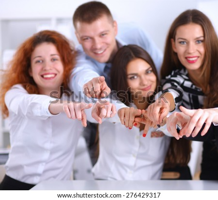 Business people group team point finger at you - stock photo