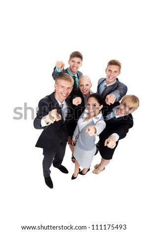 Business people group team point finger at you, young businesspeople standing together happy smile, full length portrait top angle view, Isolated over white background - stock photo