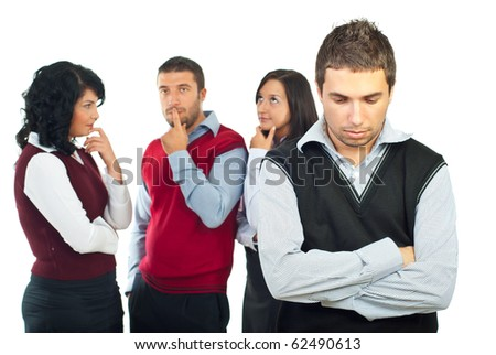 Business people group with problems thinking at solutions while a young man standing in front of camera with hands crossed and sad face - stock photo
