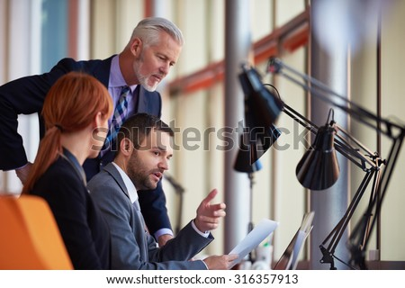 business people group with young adults and senior on meeting at modern bright office interior. - stock photo