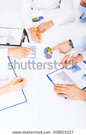 business people hands analyst team work group during conference discussing financial business charts, businesspeople accounting meeting sitting at desk office point finger at graph document - stock photo