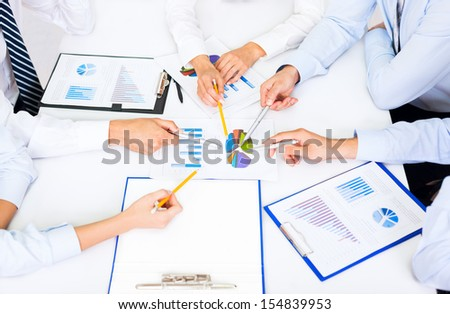 business people hands analyst team work group during conference discussing financial review, business charts, businesspeople accounting meeting sitting at desk office point finger at graph document - stock photo