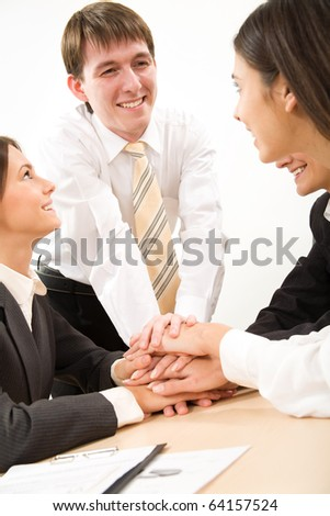 Business people hands on top of each other - stock photo
