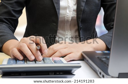 Business people hands working on the calculator - stock photo