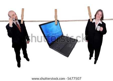 Business people hanging on a clothesline isolated on a white background - stock photo