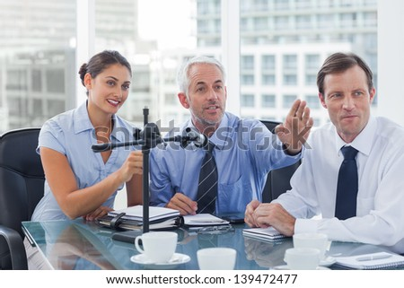 Business people having a conference in the meeting room - stock photo