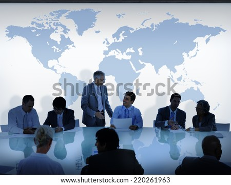 Business People Having a Discussion and World Map - stock photo