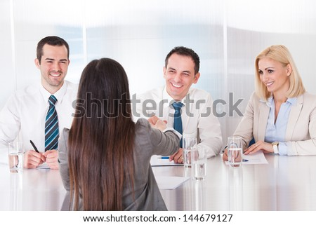 Business People Having A Handshake In Office - stock photo