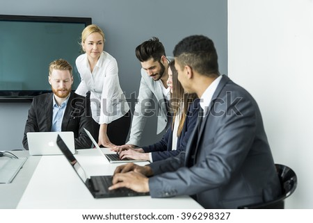 Business people having a meeting in the office - stock photo