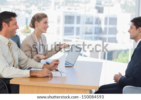 Business people having an interview in their office - stock photo