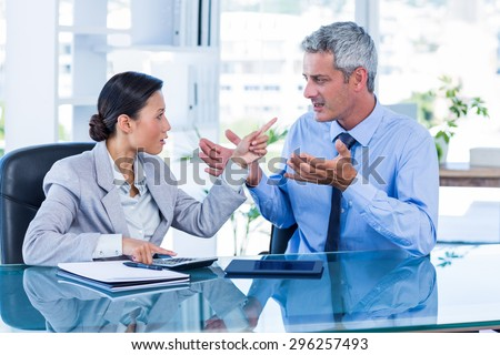 Business people having argument in office - stock photo