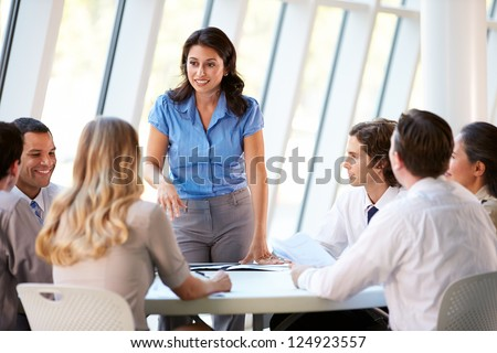 Business People Having Board Meeting In Modern Office - stock photo