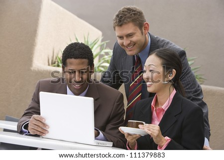 Business people having discussion during coffee break - stock photo