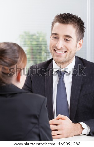 Business people having job interview with young woman  - stock photo
