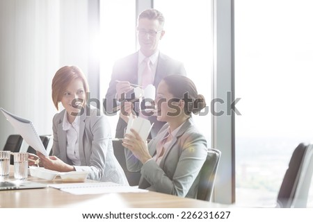 Business people having lunch break - stock photo