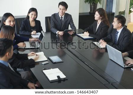 Business people having meeting - stock photo