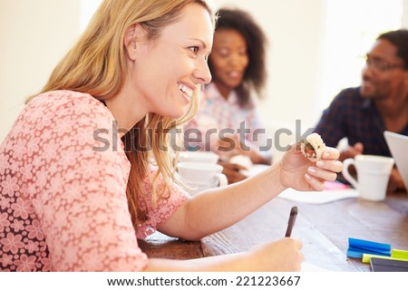 Business People Having Meeting And Eating Sushi - stock photo