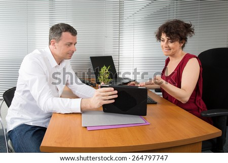 Business people Having Meeting Around Table In Modern Office - stock photo