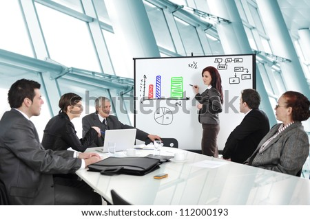 Business people having on presentation at office. Businesswoman presenting on whiteboard. - stock photo