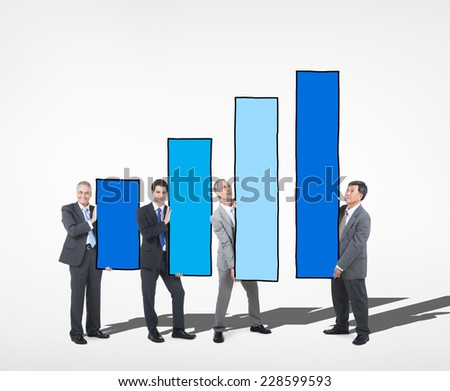 Business People Holding Bar Graph - stock photo