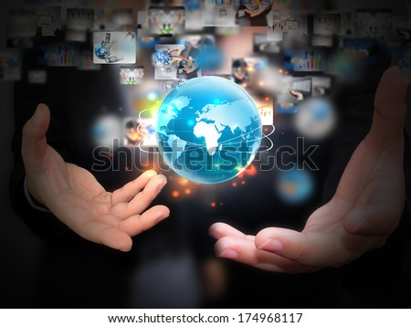 Business people holding business world - stock photo