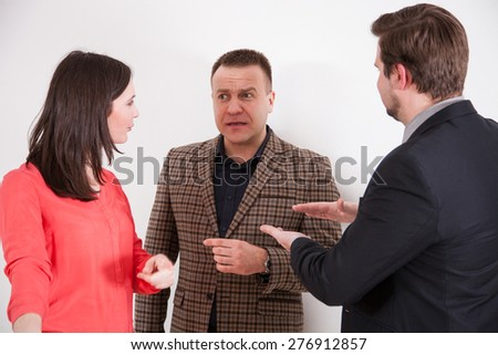 Business people holding debate, neutral background - stock photo