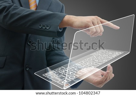Business people holding finger on glass laptop touch screen. - stock photo